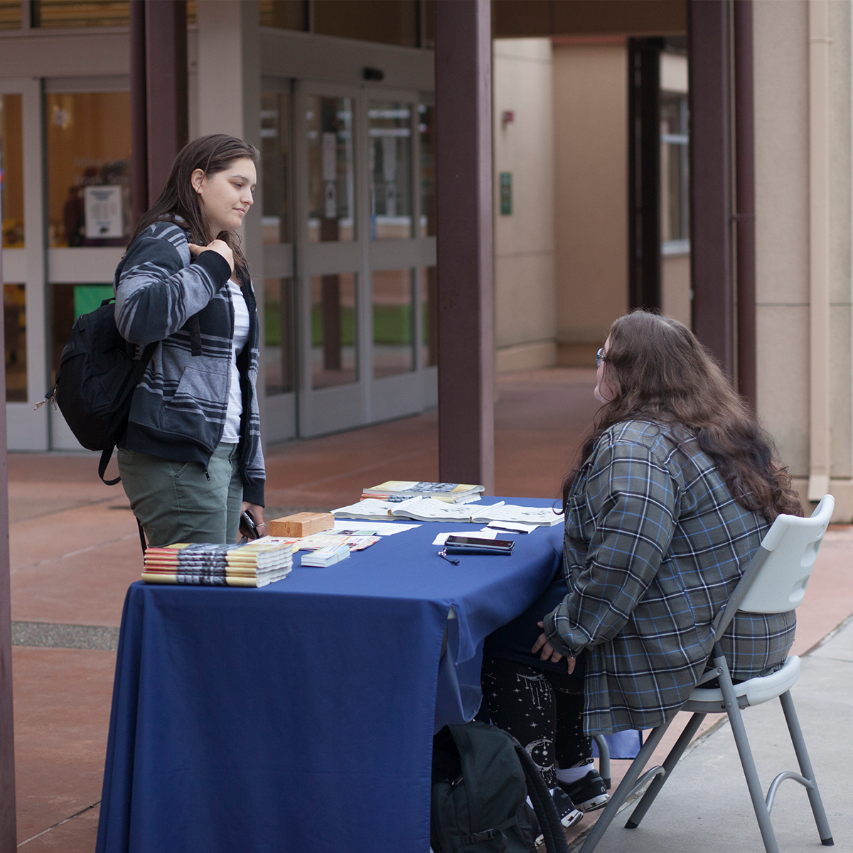 Two students talking in Rotary Plaza on the Petaluma Campus